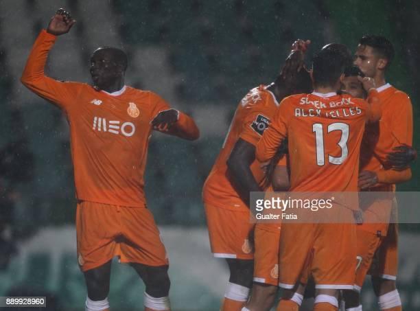 Porto forward Vincent Aboubakar from Cameroon celebrates with teammates after scoring a goal during the Primeira Liga match between Vitoria Setubal...