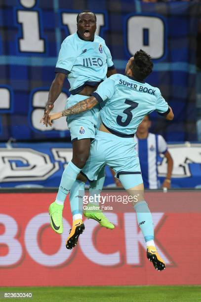 Porto forward Vincent Aboubakar from Cameroon celebrates with teammate FC Porto defender Alex Telles from Brazil after scoring a goal during the...