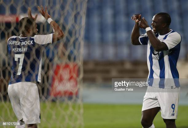 Porto forward Vincent Aboubakar from Cameroon celebrates with teammate FC Porto midfielder Hernani from Portugal after scoring a goal during the...