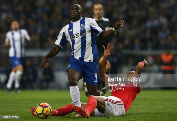Porto forward Vincent Aboubakar from Cameroon tackled by SL Benfica defender Luisao from Brazil during the Primeira Liga match between FC Porto and...