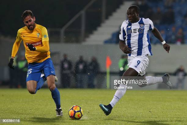 Porto forward Vincent Aboubakar from Cameroon with GD Estoril Praia midfielder Charis Kyriakou from Cyprus in action during the Primeira Liga match...