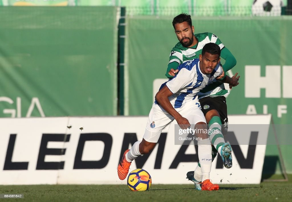 FC Porto forward Wenderson Galeno from Brazil with Sporting CP B midfielder Pedro Delgado in action during the Segunda Liga match between Sporting CP B and FC Porto B at CGD Stadium Aurelio Pereira on December 2, 2017 in Alcochete, Portugal.