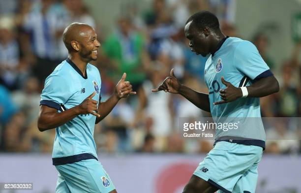Porto forward Yacine Brahimi from Algeria celebrates with teammate FC Porto forward Vincent Aboubakar from Cameroon after scoring a goal during the...