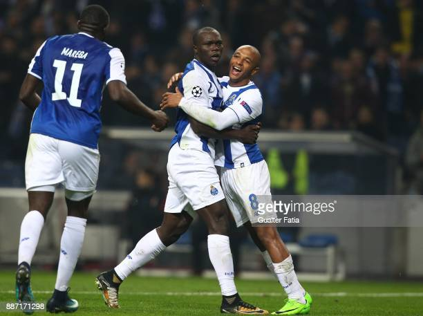 Porto forward Yacine Brahimi from Algeria celebrates with teammate FC Porto forward Vincent Aboubakar from Camaroes after scoring a goal during the...