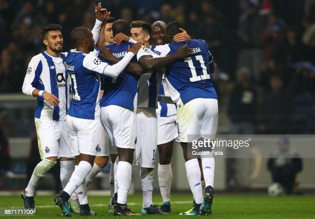 Porto forward Yacine Brahimi from Algeria celebrates with teammates after scoring a goal during the UEFA Champions League match between FC Porto and...