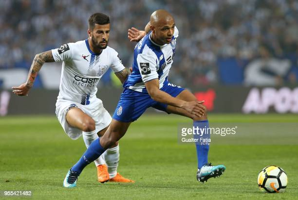 Porto forward Yacine Brahimi from Algeria with CD Feirense midfielder Tiago Silva from Portugal in action during the Primeira Liga match between FC...