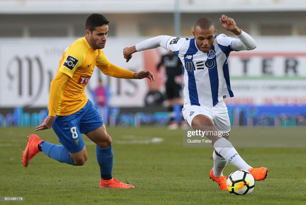 FC Porto forward Yacine Brahimi from Algeria with GD Estoril Praia midfielder Eduardo Teixeira from Brazil in action during the Primeira Liga match between GD Estoril Praia and FC Porto at Estadio Antonio Coimbra da Mota on February 21, 2018 in Estoril, Portugal.