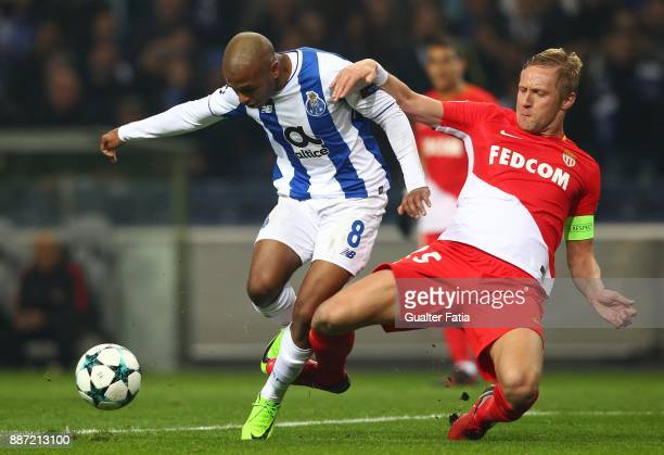 Porto forward Yacine Brahimi from Algeria with Monaco defender Kamil Glik from Poland in action during the UEFA Champions League match between FC...