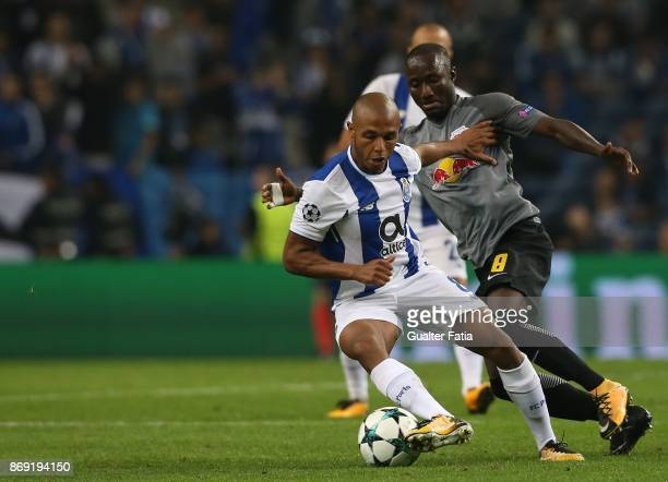 Porto forward Yacine Brahimi from Algeria with RB Leipzig midfielder Naby Keita from Guine in action during the UEFA Champions League match between...