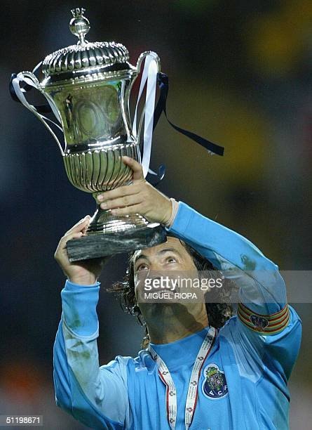 Porto goalkeeper and captain Vitor Baia shows the trophy after winning 10 against SL Benfica's the Supercup Candido de Oliveira at Municipal Stadium...
