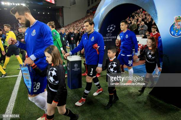 Porto goalkeeper Iker Casillas walks out flanked by Felipe and Diogo Dalot during the UEFA Champions League Round of 16 Second Leg match between...