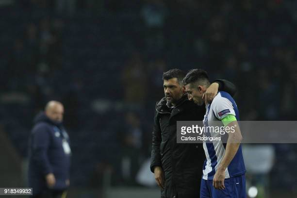 Porto head coach Sergio Conceicao from Portugal and FC Porto midfielder Hector Herrera from Mexico at the end of the UEFA Champions League Round of...
