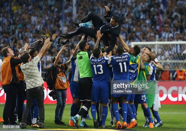 Porto head coach Sergio Conceicao from Portugal celebrates the league title with players at the end of the Primeira Liga match between FC Porto and...