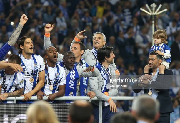 Porto head coach Sergio Conceicao from Portugal celebrates winning the Portuguese Primeira Liga with his family and players at the end of the...