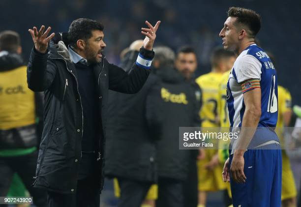 Porto head coach Sergio Conceicao from Portugal talks to FC Porto midfielder Hector Herrera from Mexico at the end of the Primeira Liga match between...