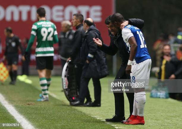 Porto head coach Sergio Conceicao from Portugal talks to FC Porto forward Majeed Waris from Ghana during the Taca da Liga Semi Final match between...