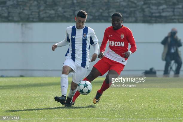 Porto midfielder Afonso Gamelas De Pinho Sousa vies with Monaco defender Yannis Yapende from France for the ball possession during the match between...