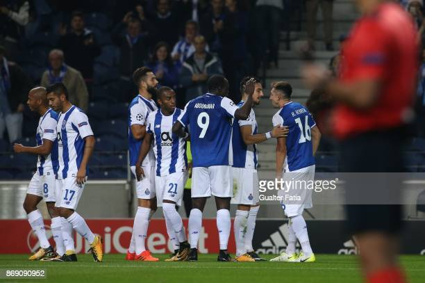Porto midfielder Hector Herrera from Mexico celebrates with teammates after scoring a goal during the UEFA Champions League match between FC Porto...