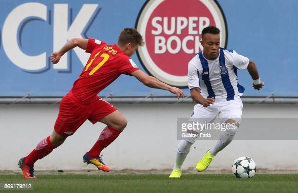 Porto midfielder Matheus Barbosa Santos with RB Leipzig defender Marcel Hoppe from Germany in action during the UEFA Youth League match between FC...