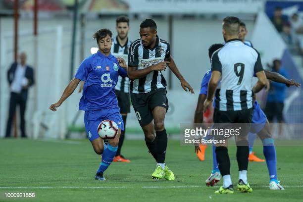 Porto midfielder Oliver Torres from Spain vies with Portimonense SC midfielder Dener Clemente from Brazil for the ball possession during the...