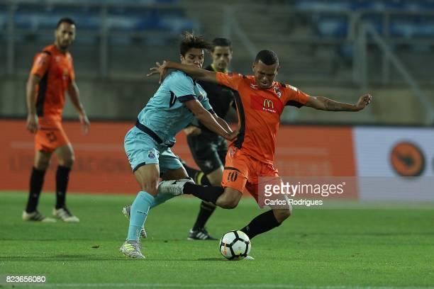 Porto midfielder Oliver Torres from Spain vies with Portimonense SC midfielder Ewerton Pereira from Brazil during the PreSeason Friendly match...