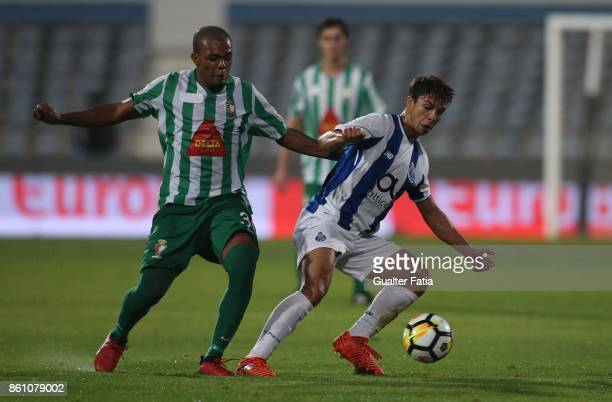 Porto midfielder Oliver Torres from Spain with Lusitano Ginasio Clube forward Jair Nunes from Sao Tome in action during the Portuguese Cup match...