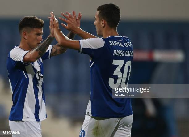 Porto midfielder Otavio from Brazil celebrates with FC Porto defender Diogo Dalot from Portugal after scoring a goal during the Portuguese Cup match...