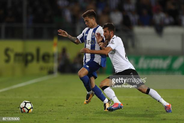 Porto midfielder Otavio from Brazil vies Vitoria Guimaraes defender Josue Sa from Portugal during the match between Vitoria Guimaraes v FC Porto...