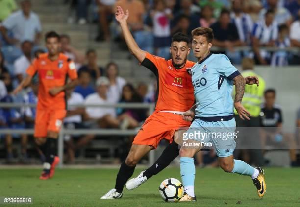 Porto midfielder Otavio from Brazil with Portimonense SC midfielder Pedro Sa from Portugal in action during the PreSeason Friendly match between...