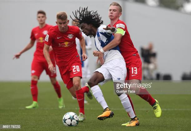 Porto midfielder Romario Baro with RB Leipzig midfielder Erik Majestschak from Germany in action during the UEFA Youth League match between FC Porto...