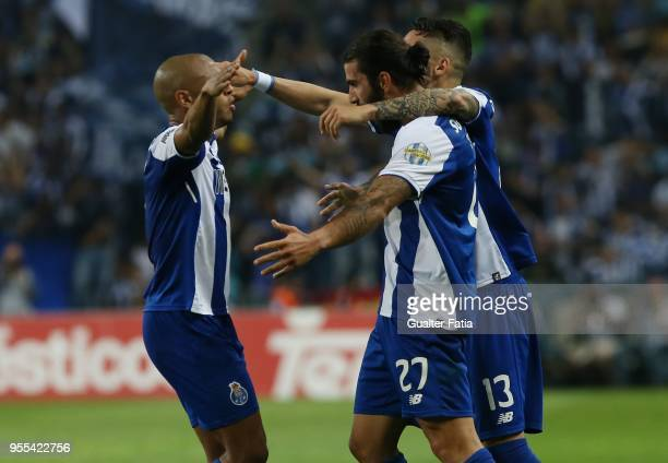 Porto midfielder Sergio Oliveira from Portugal celebrates with teammates after scoring a goal during the Primeira Liga match between FC Porto and CD...
