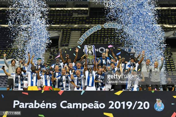 Porto players and staff celebrate with the trophy after winning the league title following the Liga Nos match between FC Porto and Moreirense FC at...