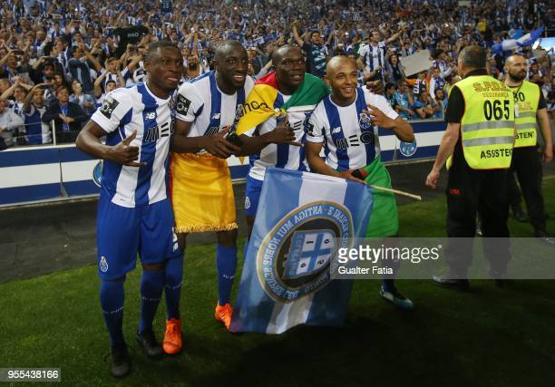 Porto players celebrate the league title with players at the end of the Primeira Liga match between FC Porto and CD Feirense at Estadio do Dragao on...