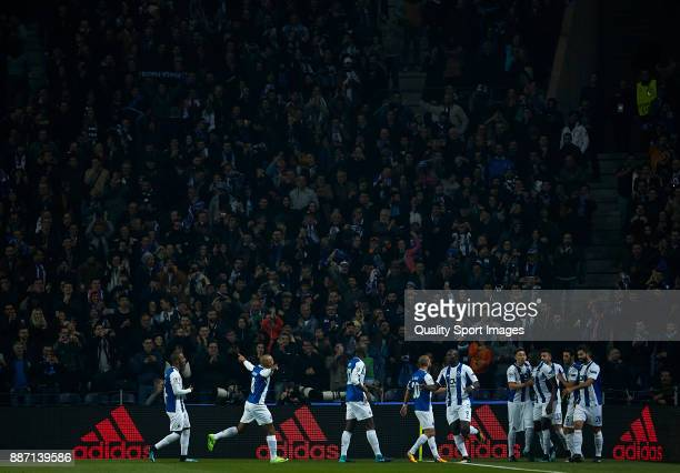 Porto players celebrate the opening goal scored by Vincent Aboubakar of FC Porto during the UEFA Champions League group G match between FC Porto and...