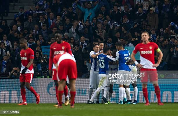 Porto players celebrate the thrid goal scored by Yacine Brahimi of FC Porto during the UEFA Champions League group G match between FC Porto and AS...