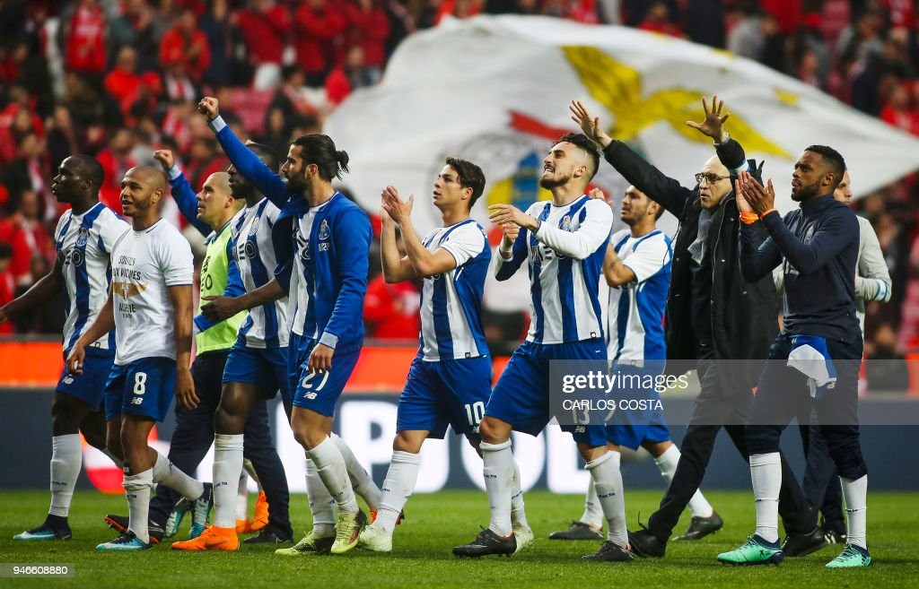Porto players celebrate their victory at the end of the Portuguese league footbal match between SL Benfica and FC Porto at the Luz stadium in Lisbon on April 15, 2018. /