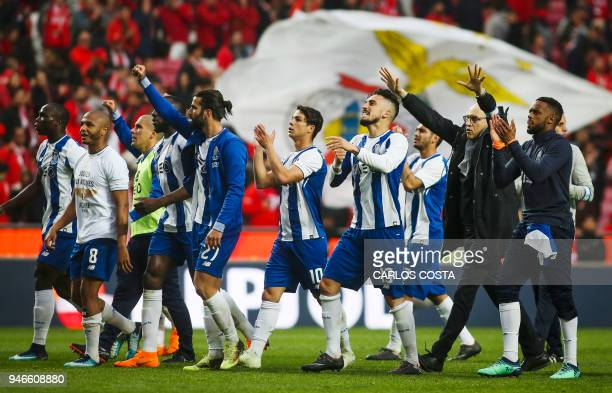 Porto players celebrate their victory at the end of the Portuguese league footbal match between SL Benfica and FC Porto at the Luz stadium in Lisbon...