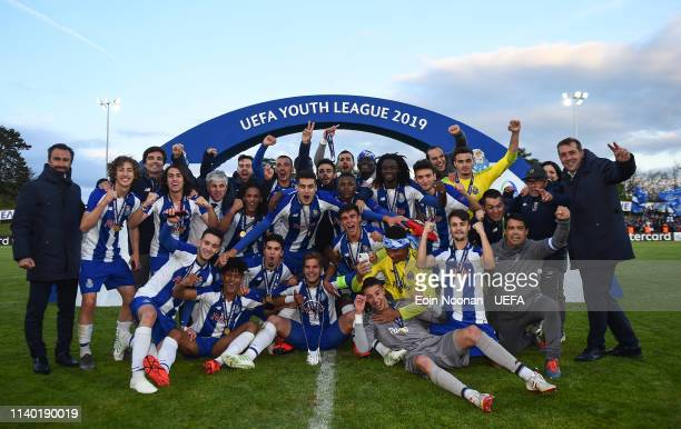 Porto players celebrate with the Lennart Johansson trophy after the Porto v Chelsea UEFA Youth League Final at Colovray Sports Centre on April 29...