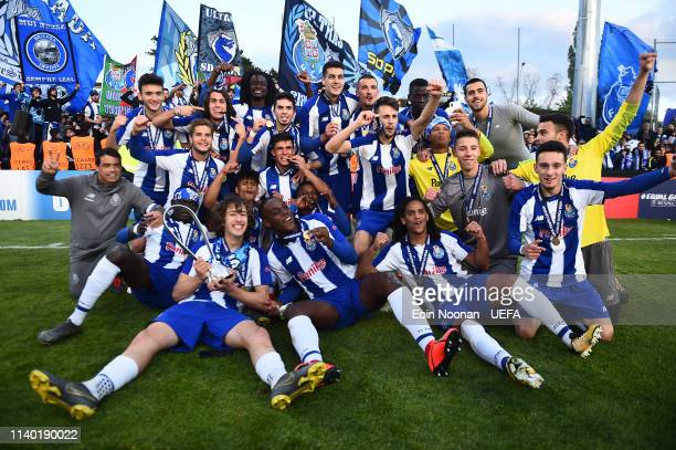 Porto players celebrate with the Lennart Johansson trophy after the Porto v Chelsea UEFA Youth League Final at Colovray Sports Centre on April 29,...