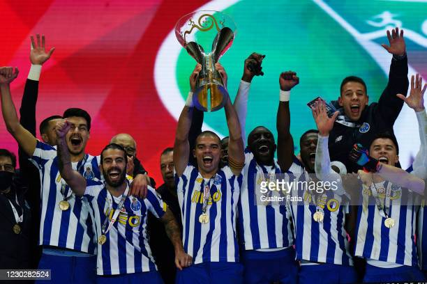 Porto players celebrate with trophy after winning the Portuguese Super Cup at the end of the Portuguese Super Cup match between FC Porto and SL...