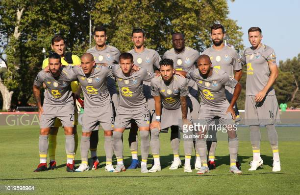 Porto players pose for a team photo before the start of the Liga NOS match between CF Os Belenenses and FC Porto at Estadio Nacional on August 19...