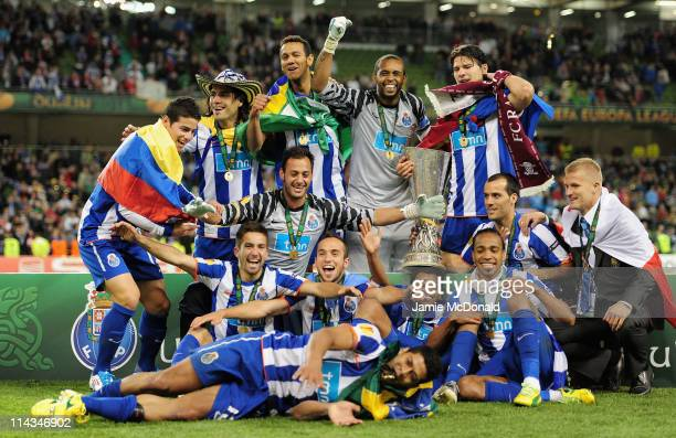 Porto players pose with the Europa league trophy during the UEFA Europa League Final between FC Porto and SC Braga at Dublin Arena on May 18 2011 in...