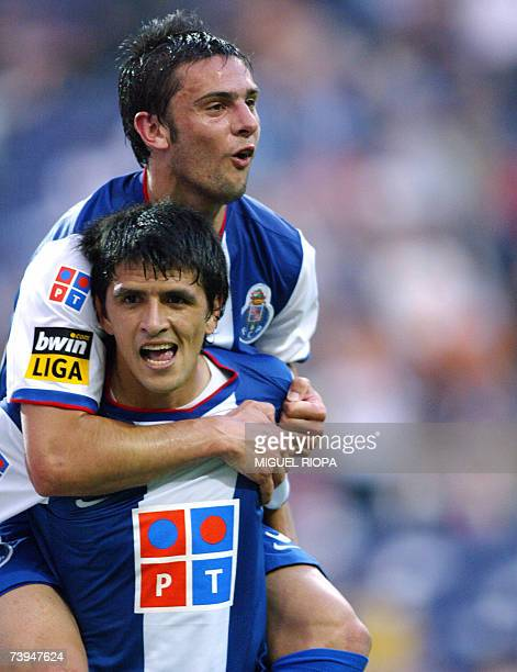 FC Porto's Argentine Lucho Gonzalez celebrates with teammate Helder Postiga after scoring against Belenenses during their Portuguese Super League...