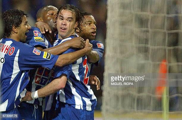 FC Porto's Brazilian Adriano Louzada celebrates with teammates Jorge Luiz Pereira 'Jorginho' from Brazil Southafrican Benny McCarthy and Brazilian...