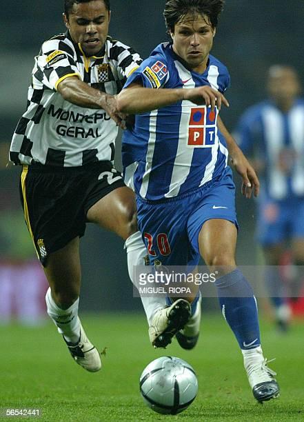 FC Porto's brazilian Diego Ribas vies with Boavista FC's Joao Da Silva 'Lucas' during their Portuguese Super League football match at Dragao Stadium...