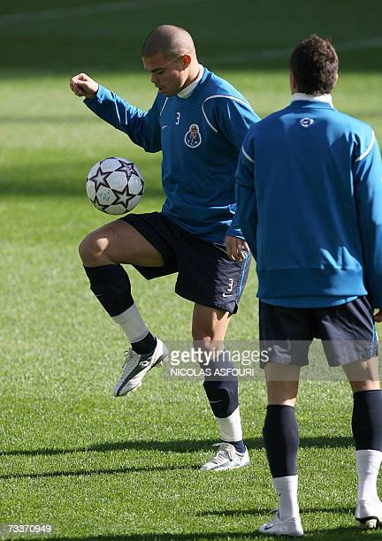 FC Porto's Pepe plays with the ball next to a teammate during a training session ahead of their Champions League football match against Chelsea at...