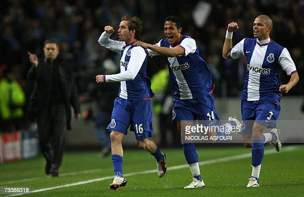 FC Porto's Raul Meireles celebrates after he scored the opening goal with teammate Bruno Alves and Pepe as Chelsea's coach Jose Mourinho gestures...