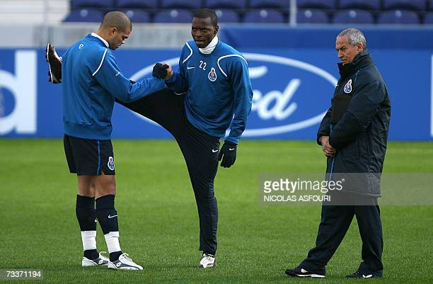 Porto's coach Josualdo Ferreira walks on the pitch as Pepe warms up with new signing from Colombia Wason Renteria during their training session ahead...