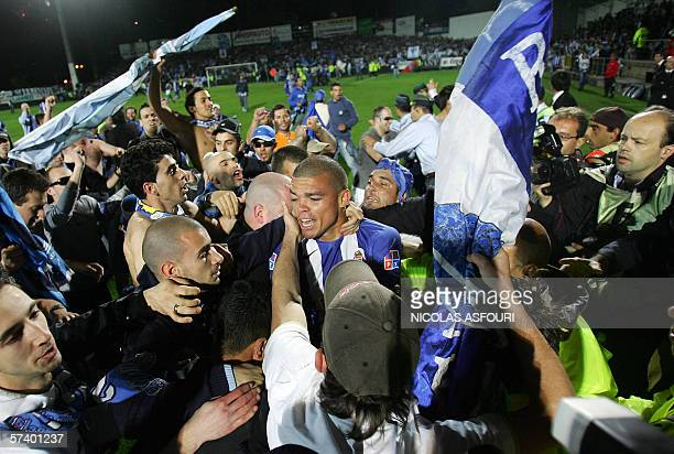Porto's Pepe is mobbed by supporters as they invade the pitch before the end of the game during the Porto vs Penafiel Portuguese Premier League match...