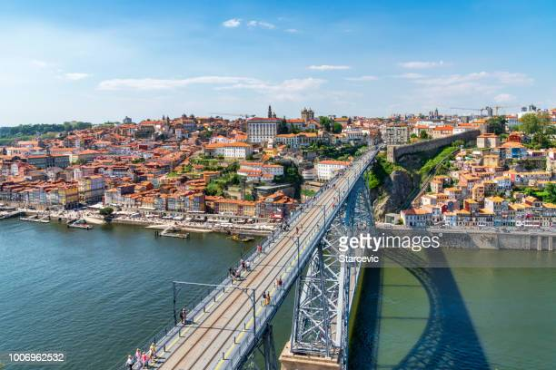porto, portugal skyline with dom luis bridge - porto portugal stock pictures, royalty-free photos & images